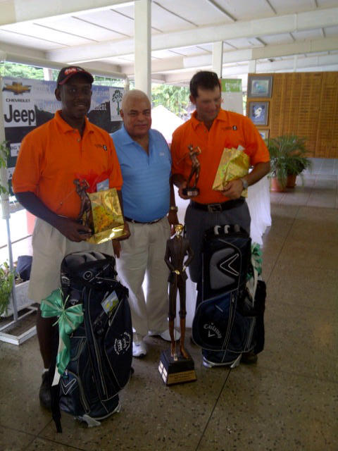 1st place winners Deryck Gonsalves & Eric Griffith pose with Raoul John, Managing Partner of KPMG & President of St. Andrew's Golf Club